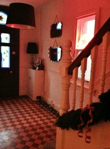 Conifer garland and neon merry Christmas (ignore the half restored floor tiles!)