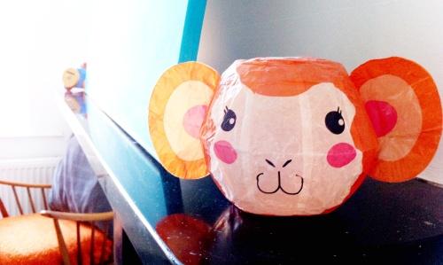 A Japanese paper monkey keeps watch